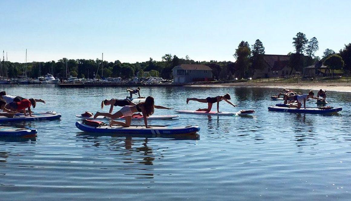 sup yoga sister bay beach